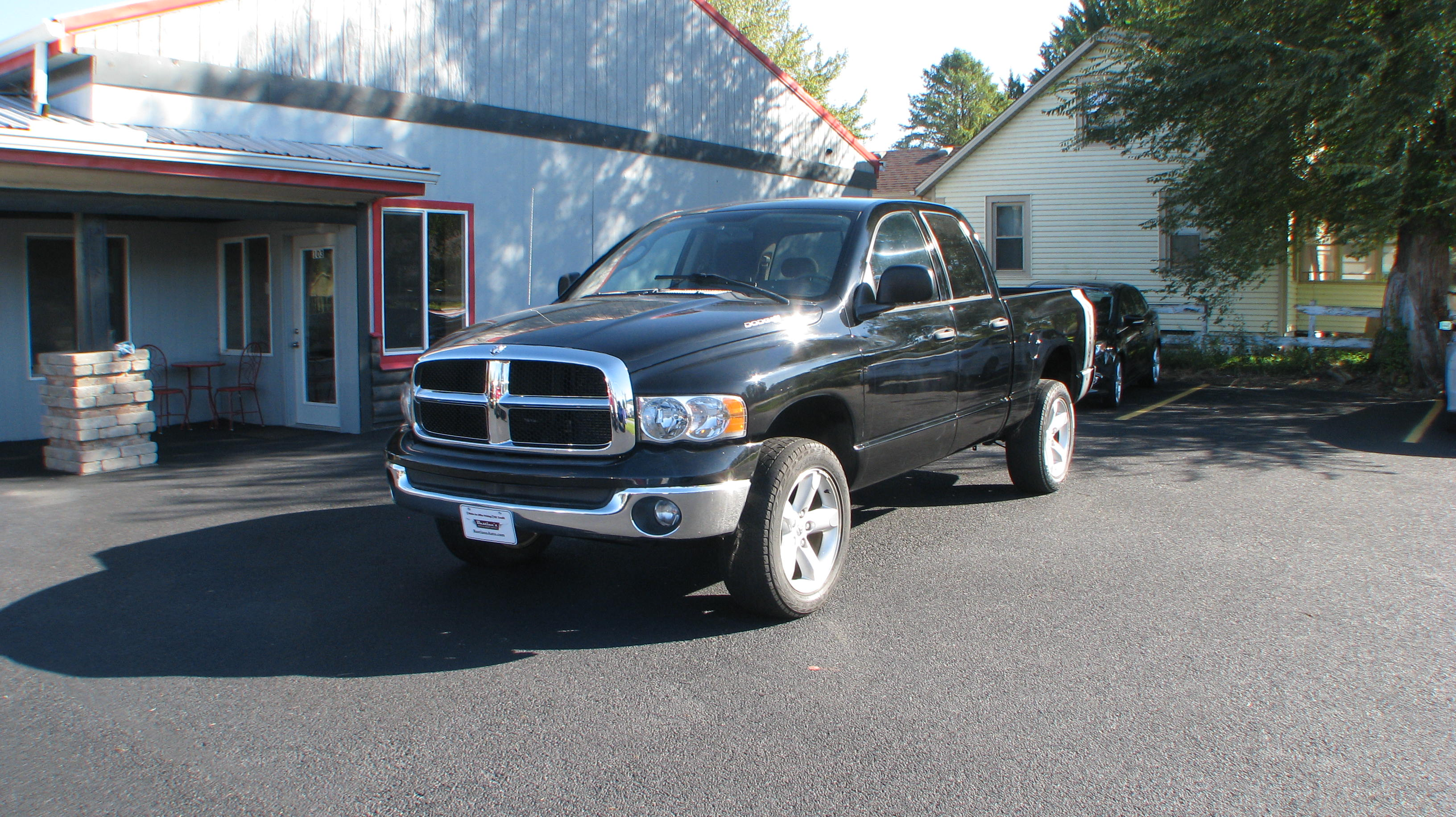 Pre-Owned 2005 Dodge Ram 1500 4WD Quad Cab SLT