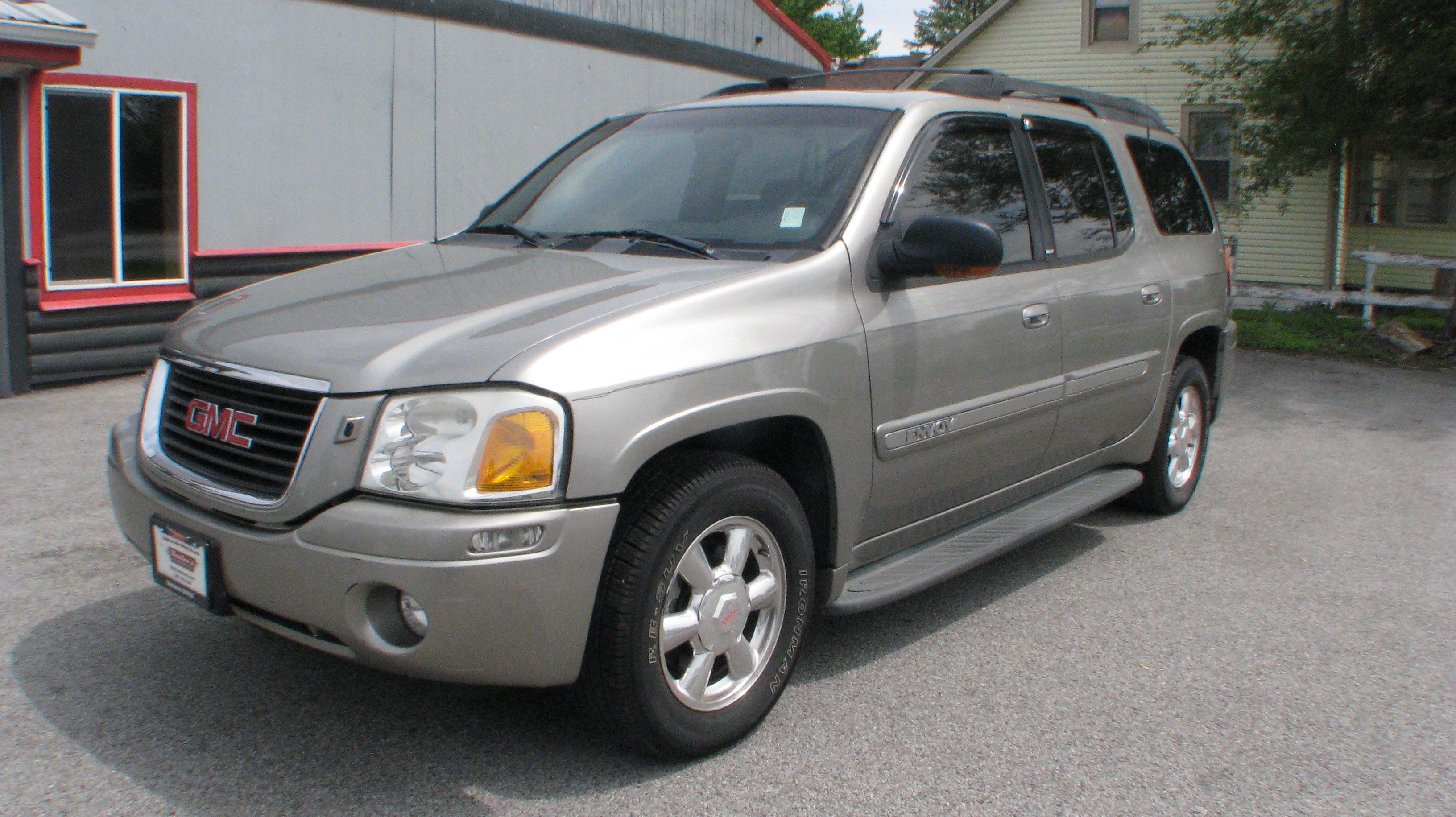 pre owned 2003 gmc envoy xl 4d suv 4wd slt sport utility. Black Bedroom Furniture Sets. Home Design Ideas